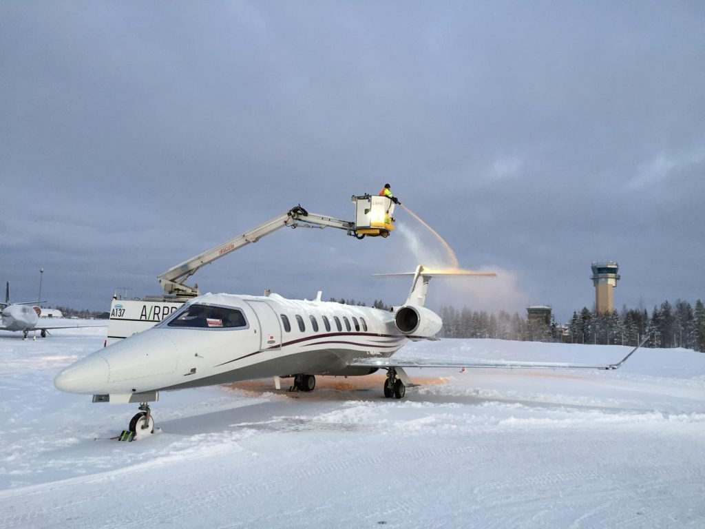 Deicing Learjet 75 at Rovaniemi Airport}