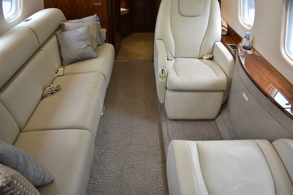 Embraer Legacy 650 interior rear of private jet