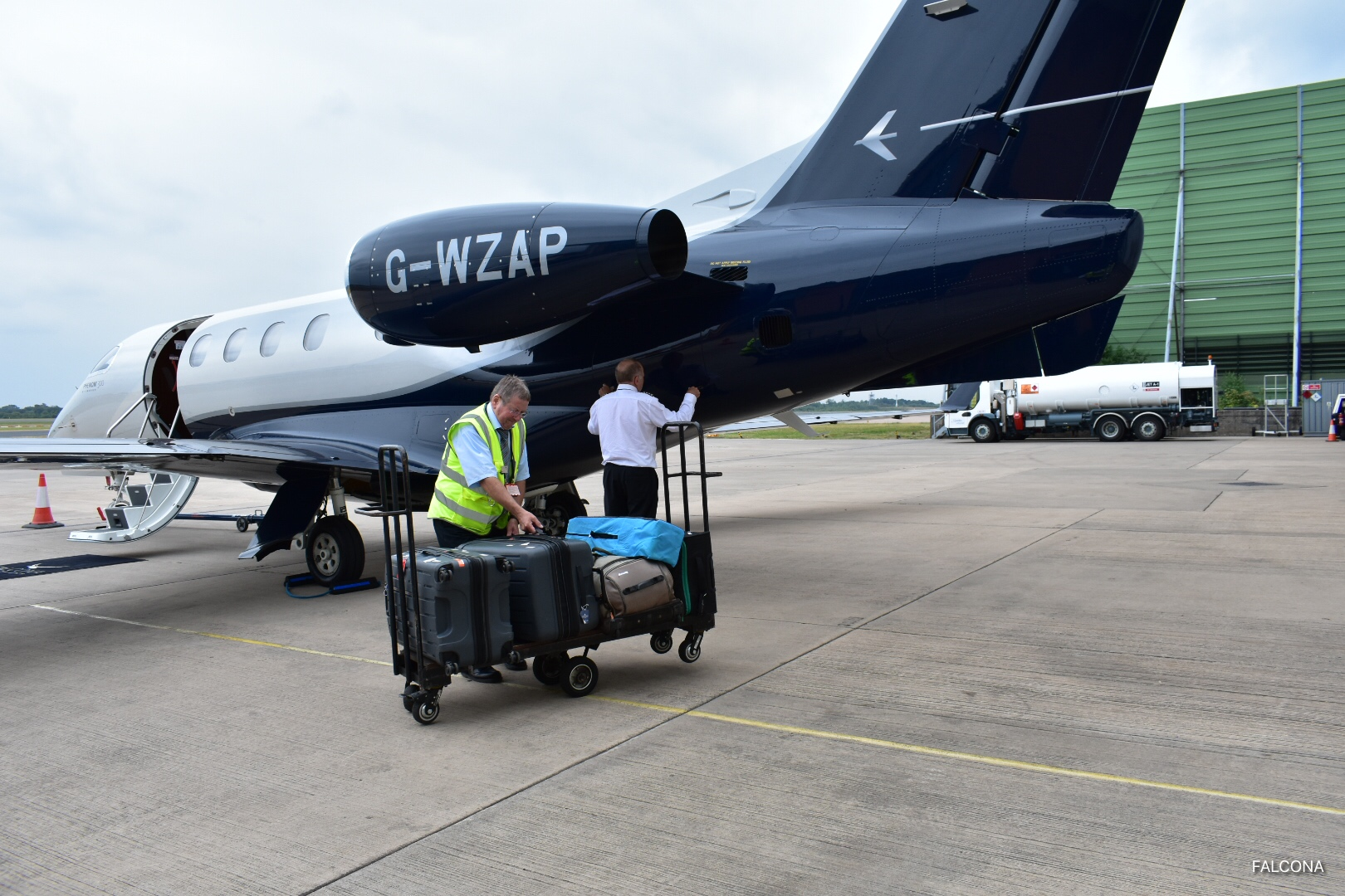 Embraer Phenom 300 loading luggage private jet