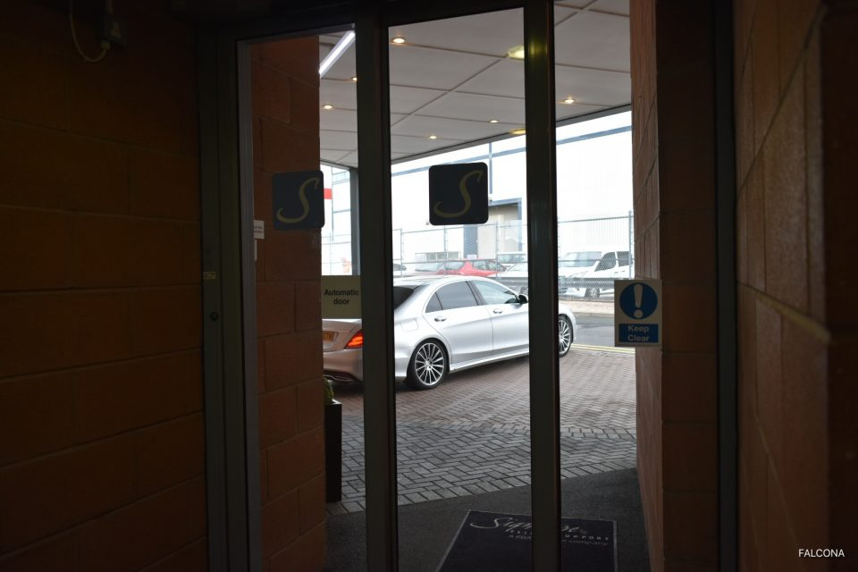 VIP lounge at Manchester Airport with chauffeur car outside