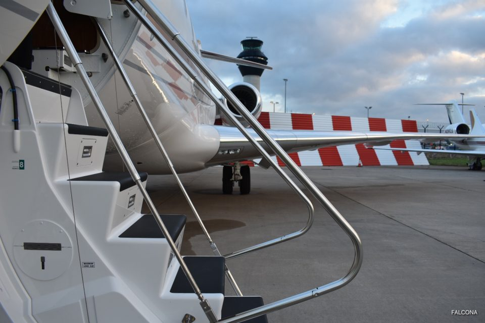 Bombardier Global 5000 steps at manchester airport