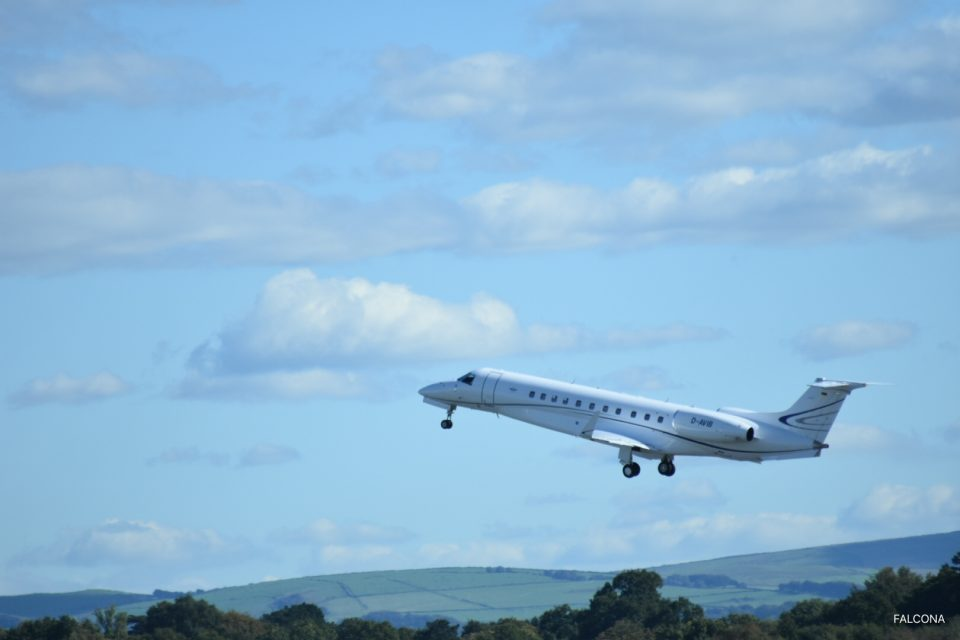 New Embraer Legacy 650 taking off from Manchester Airport}
