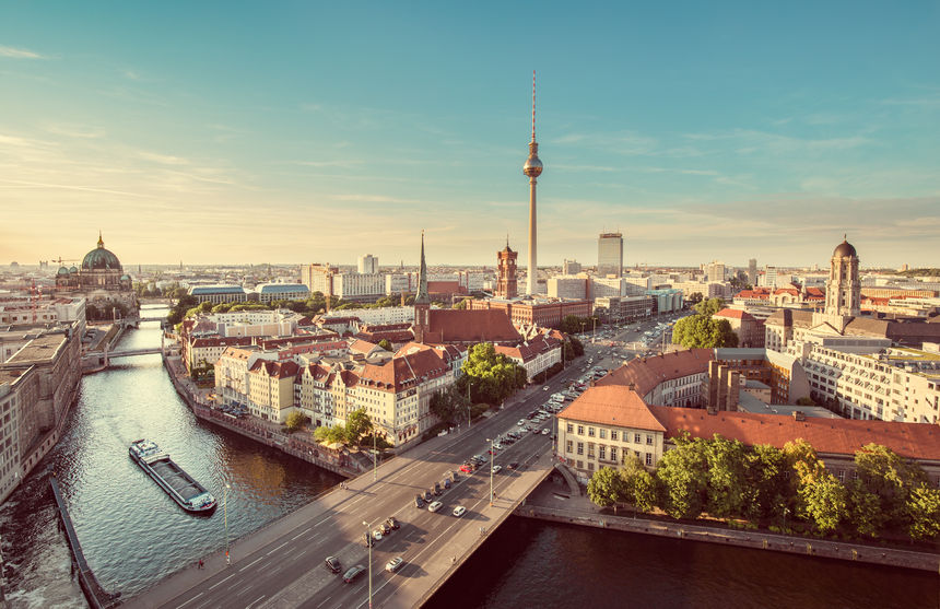 Berlin skyline with famous tv tower and Spree river in beautiful evening light at sunset}