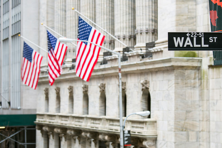 wall street sign in new york with new york stock exchange background
