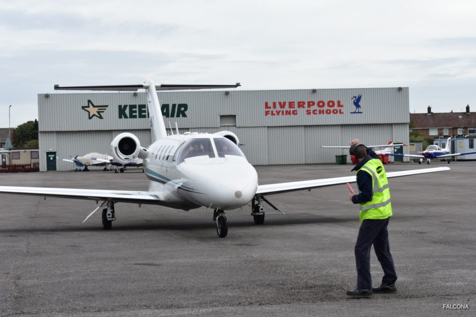 Marshalling aircraft at Liverpool Airport}