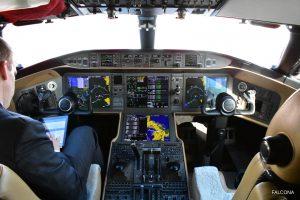 Pilot in Bombardier Global 6000 cockpit