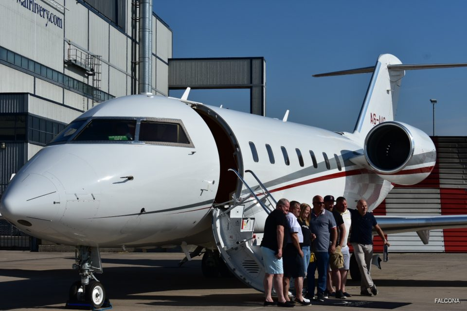 Bombardier Challenger 605 private jet at manchester airport with passengers flying to russia