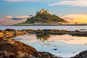 Penzance, Cornwall, United Kingdom - August 9, 2016: View of St Michael's Mount in Cornwall at sunset