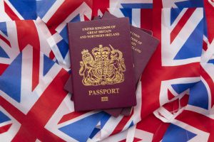 United Kingdom travel passport on a Great Britain Union Jack flag