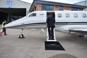 Private jet pilot boarding phenom 300